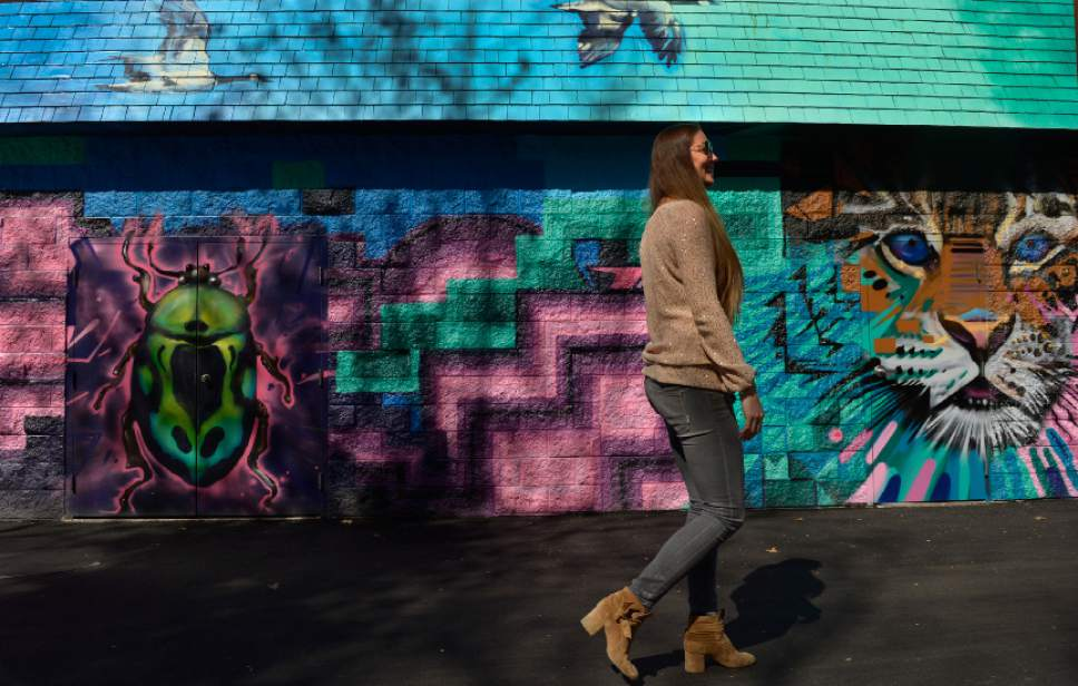 Leah Hogsten  |  The Salt Lake Tribune  Third-generation Lagoon owner Julie Freed walks past the new mural in the park's Kiddie Land section painted by muralist Benjamin Weimeyer.