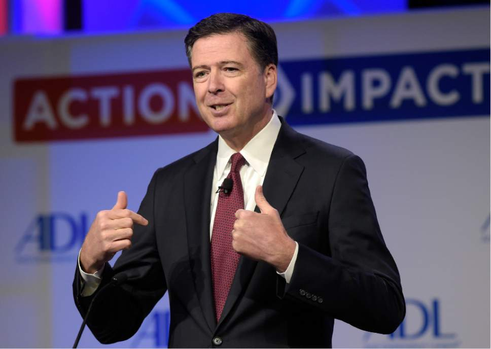 FILE - In this May 8, 2017, file photo, then-FBI Director James Comey speaks to the Anti-Defamation League National Leadership Summit in Washington. The White House is disputing a report that President Donald Trump asked Comey to shut down an investigation into ousted national security adviser Michael Flynn. (AP Photo/Susan Walsh, File)