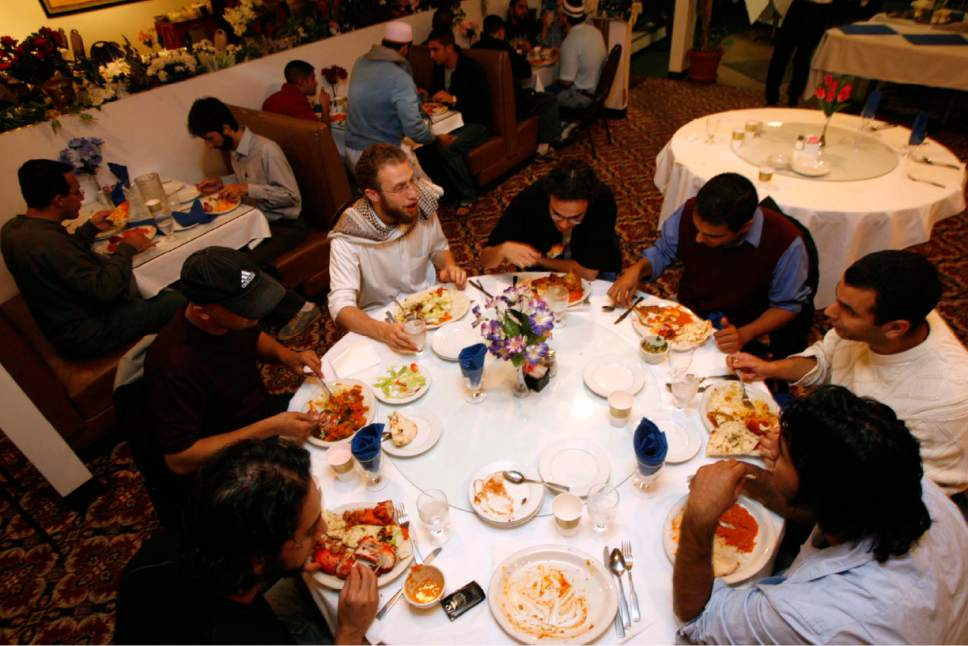 Trent Nelson  |  Tribune file photo About 50 members of the Muslim Students Association of the University of Utah held a group Iftar at Taj India in 2007.  Two Salt Lake City Mormon wards plan to host area Muslims for such an iftar meal on June 4, 2017.