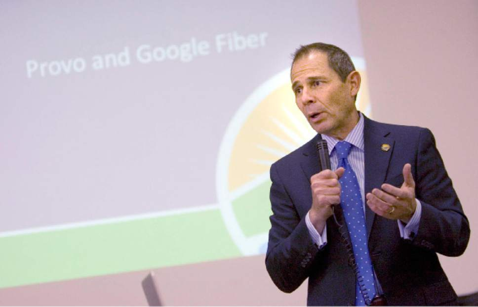 Tribune File Photo Provo  Mayor John Curtis discusses the Google Fiber network at a public question and answer meeting at Provo's Edgemont School on Thursday, April 18, 2013.