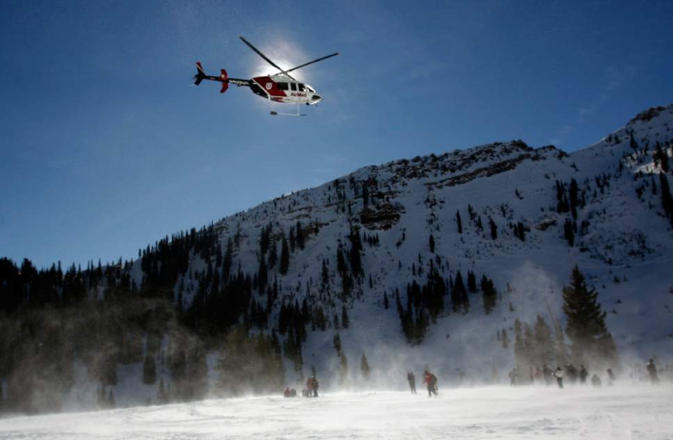 Rick Egan   |  The Salt Lake Tribune  An AirMed helicopter stirs up the snow as it searches for a signal from a beacon, in Mineral Basin at Snowbird Ski Resort.  Wasatch Backcountry Rescue (WBR), University of Utah Health Care's AirMed and the Salt Lake County Sheriff's conducted a backcountry rescue training at Snowbird,Friday, January 8, 2010 Members of the Snowbird Ski Patrol, WBR and AirMed used long-range receivers (beacon locator equipment) in a simulated avalanche rescue, with the assistance of Snowbird avalanche rescue dogs.