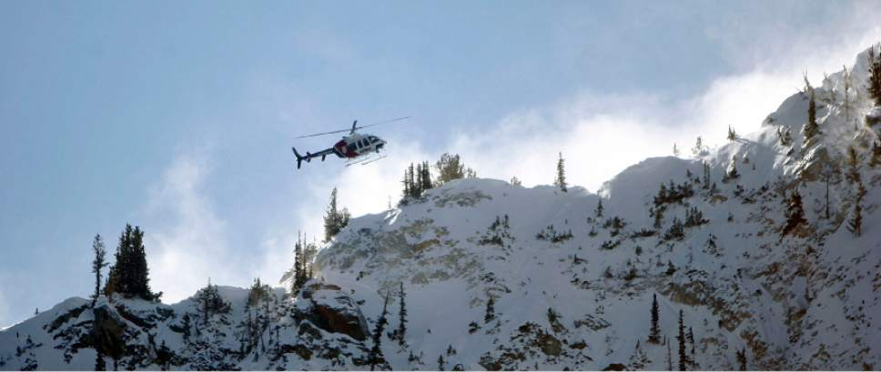Francisco Kjolseth  |  The Salt Lake Tribune  An AirMed chopper flies into Dog lake near Brighton resort to drop-off a local highly-trained avalanche rescue dog team on Wednesday, January 25, 2012 to do avalanche victim search drills, beacon searches and helicopter training conducted by Wasatch Backcountry Rescue (WBR).