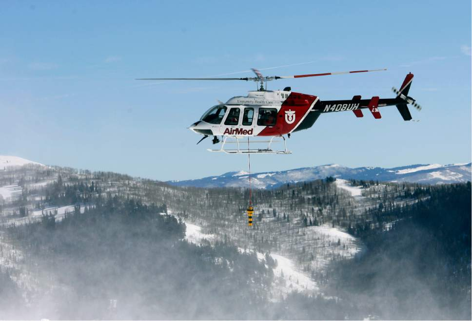 Rick Egan   |  The Salt Lake Tribune  An AirMed helicopter flies along the peaks at Snowbird during backcountry-rescue training on Friday, January 8, 2010. Members of the Snowbird Ski Patrol, Wasatch Backcountry Rescue, University of Utah Health Care's AirMed and the Salt Lake County Sheriff's Office used long-range receivers (beacon locator equipment) in a simulated avalanche rescue, with the assistance of Snowbird avalanche-rescue dogs.