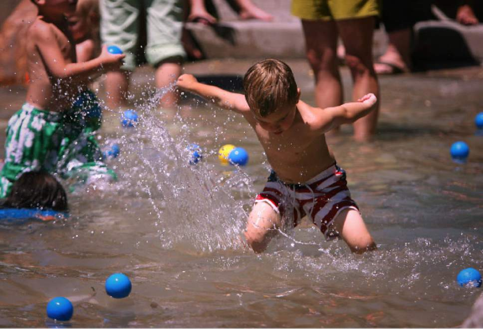 Ryan Galbraith  |  Tribune file photo   Four-year-old Fischer Adams splashes in the Seven Canyons Fountain in Liberty Park in 2006.