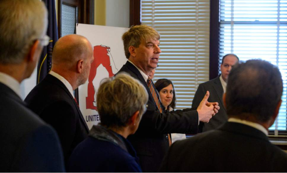 Steve Griffin  |  Tribune file photo Jim Bennett, center, is helping to organize a new centrist party of disaffected Republicans and Democrats called the Utah United Party. He is considering suing over the state's refusal to allow him to file provisionally as a candidate of the new party while it is being certified.