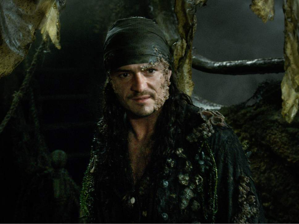 """In this image released by Disney, Orlando Bloom portrays Will Turner in a scene from """"Pirates of the Caribbean: Dead Men Tell No Tales."""" (Disney via AP)"""
