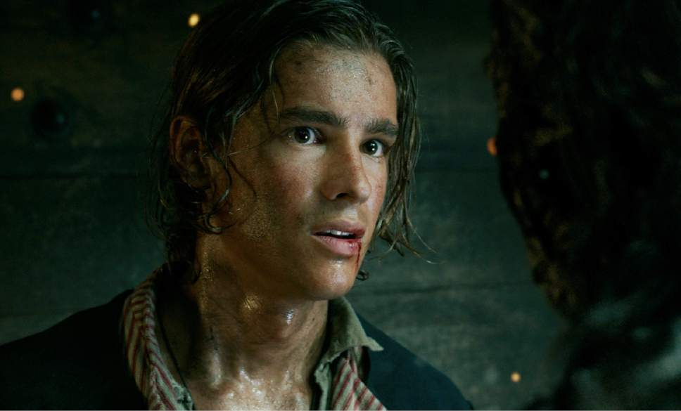 """In this image released by Disney, Brenton Thwaites portrays Henry Turner in a scene from """"Pirates of the Caribbean: Dead Men Tell No Tales."""" (Disney via AP)"""