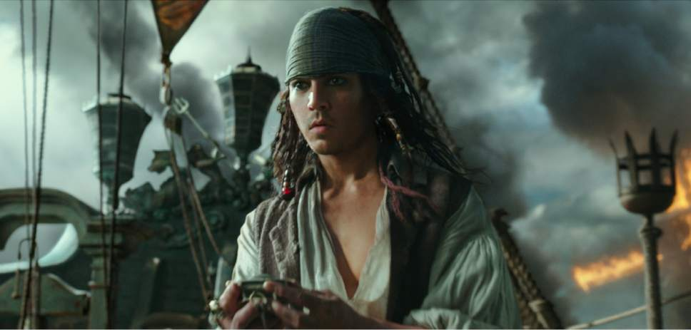 """In this image released by Disney, Johnny Depp portrays Jack Sparrow in a scene from """"Pirates of the Caribbean: Dead Men Tell No Tales."""" (Disney via AP)"""