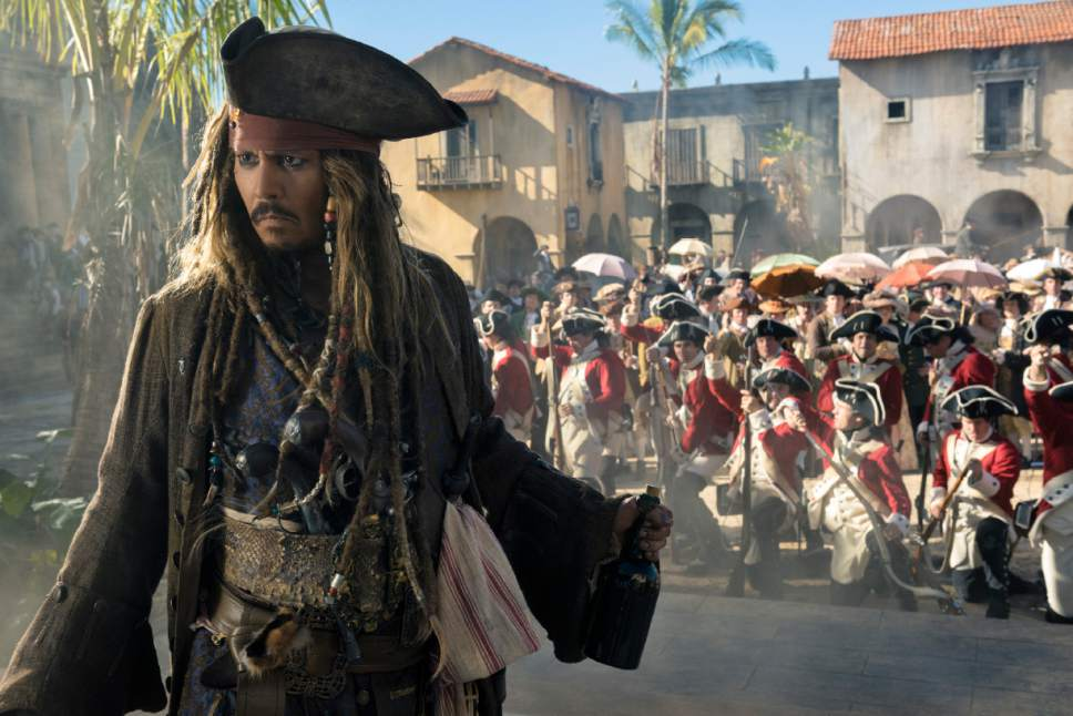 """In this image released by Disney, Johnny Depp portrays Jack Sparrow in a scene from """"Pirates of the Caribbean: Dead Men Tell No Tales."""" (Peter Mountain/Disney via AP)"""