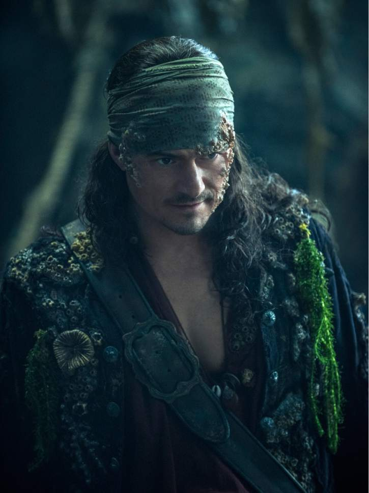 """In this image released by Disney, Orlando Bloom portrays Will Turner in a scene from """"Pirates of the Caribbean: Dead Men Tell No Tales."""" (Peter Mountain/Disney via AP)"""