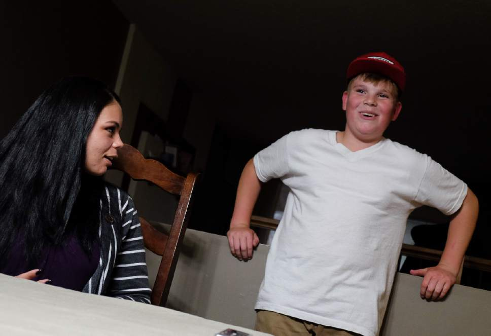 Francisco Kjolseth | The Salt Lake Tribune Lucious Richmond, 12, of Bountiful tells fun family stories alongside his mother Amanda Brunson. Not all memories are good though as he also talked about having to go into foster care for two years because both his parents struggled with an opioid addiction before cleaning themselves up.