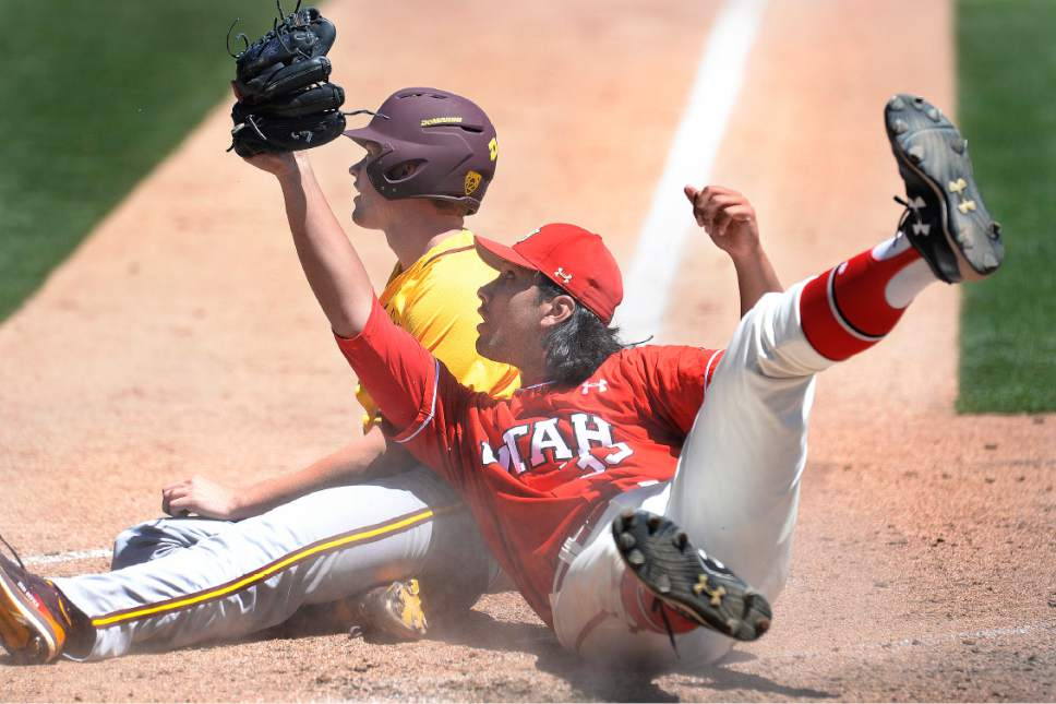 Scott Sommerdorf | The Salt Lake Tribune Utah pitcher Jacob Rebar waits for the umpire's call after he tagged ASU's Spencer Van Scoyoc out at the plate after during sixth inning play, Sunday, May 28, 2017.  ASU led the Utes 8-7 after the inning. Rebar had thrown a wild pitch that went to the backstop, but catcher Zack Moeller was able to get the ball to Rebar in time to catch An Scoyoc.