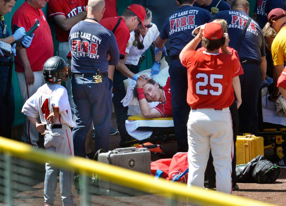Scott Sommerdorf | The Salt Lake Tribune Utah CF DaShawn Keirsey, Jr. is helped after he seriously injured himself trying to make a play on Hunter Bishop's home run during first inning play, Sunday, May 28, 2017.