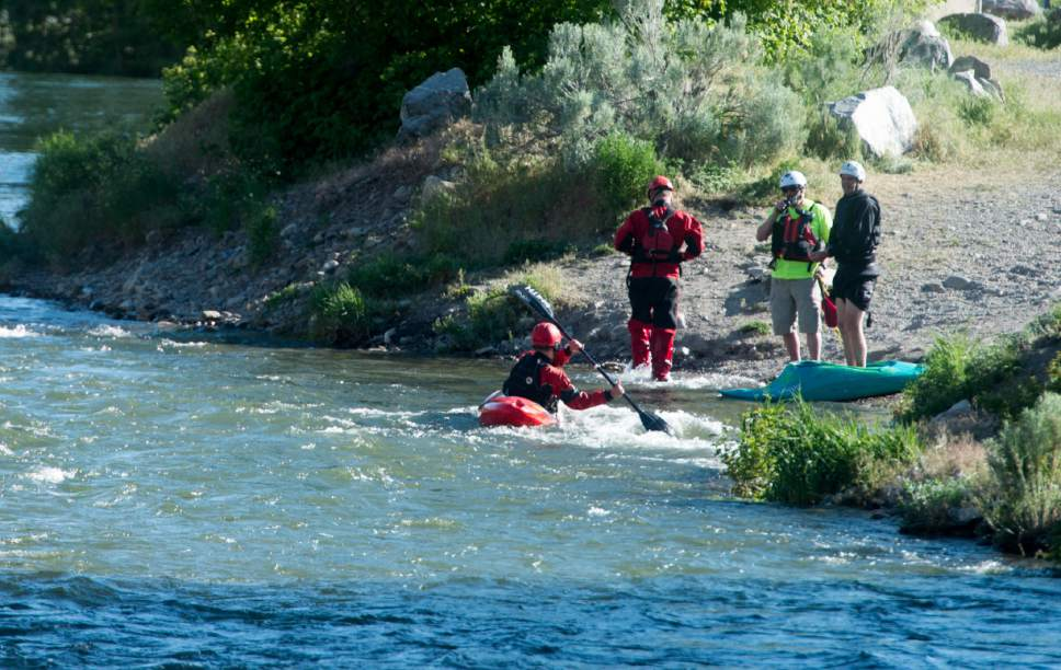 Rick Egan  |  The Salt Lake Tribune  Rescue workers search for a 4-year-old girl who was swept down the Provo River near the mouth of Provo Canyon, Monday, May 29, 2017.