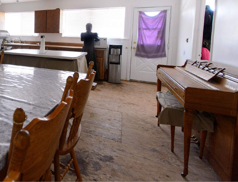 Trent Nelson  |  The Salt Lake Tribune A piano and dining room table in LeAnne Johnson's Cedar City home, Wednesday May 24, 2017. The Johnson family say they relocated to Cedar City after being evicted from UEP Trust properties in Hildale and Colorado City three times.
