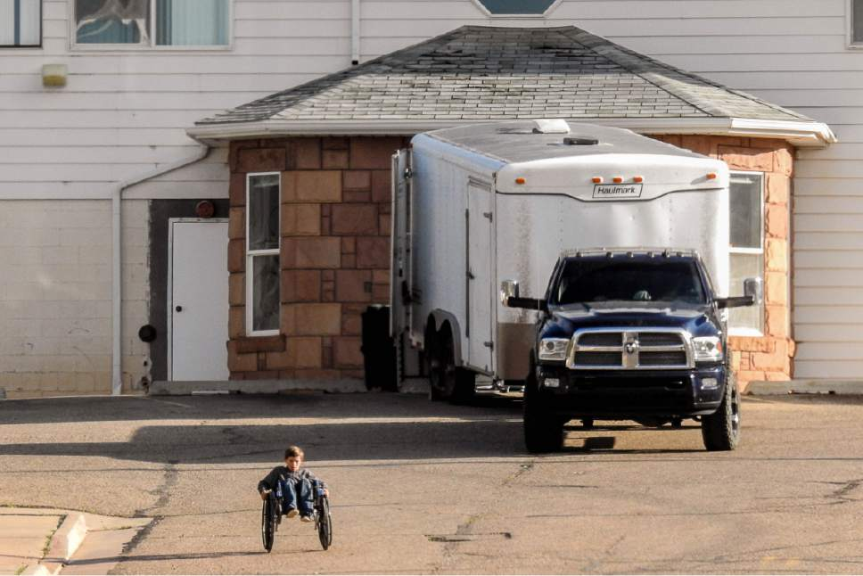 Trent Nelson  |  The Salt Lake Tribune As the former health clinic in Hildale is emptied out in anticipation of an expected UEP Trust eviction, FLDS boys are seen rolling wheelchairs down the long driveway, Monday May 8, 2017.