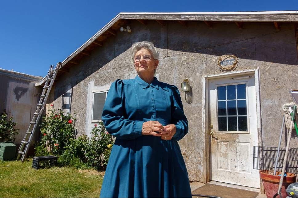Trent Nelson  |  The Salt Lake Tribune FLDS member Bonnie Ream in front of her daughter's home in Colorado City, Ariz.,earlier this moth. Ream recently moved fifty miles away to Ivins after being evicted from a UEP Trust property, but still returns occasionally to help family.