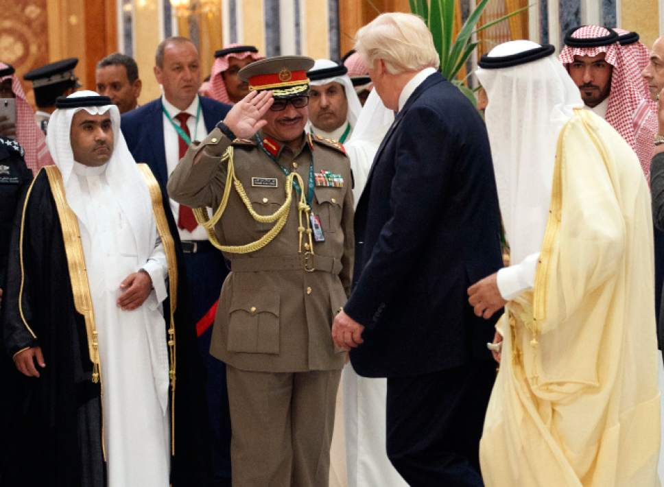 Saudi King Salman, right, and US President Donald Trump are saluted as they arrive to attend the Arab Islamic American Summit, at the King Abdulaziz Conference Center, Sunday, May 21, 2017, in Riyadh. (AP Photo/Evan Vucci)