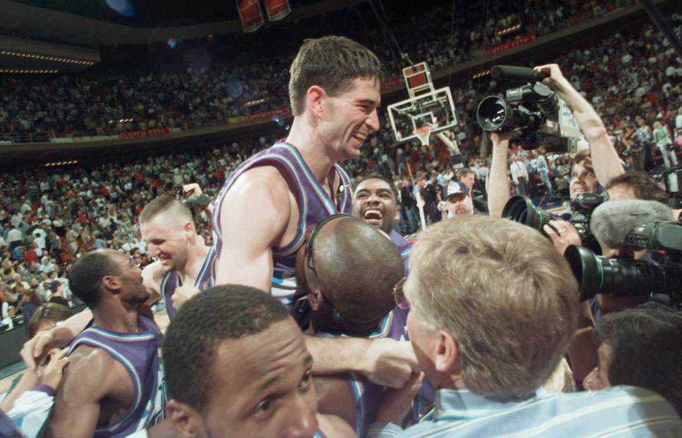 AP file photo Utah Jazz guard John Stockton is lifted on the shoulders of his teammates after sinking a 3-pointer at the buzzer to beat the Houston Rockets 103-100 in Game 6 of the Western Conference Finals on May 29, 1997, in Houston.