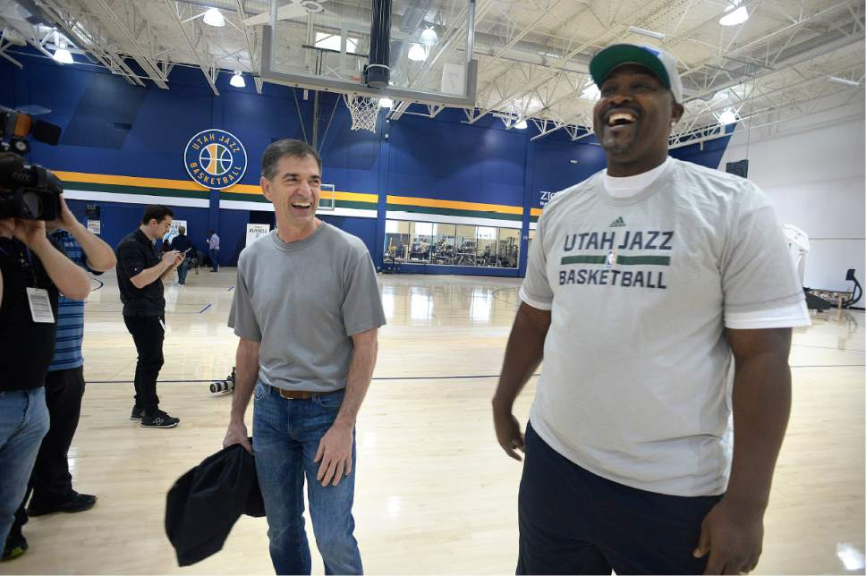 Scott Sommerdorf | The Salt Lake Tribune Former Jazz players John Stockton, left, and Bryan Russell joke about old times as Jazz players from the 1997 team were reunited at the Jazz practice facility, Wednesday, March 22 2017.