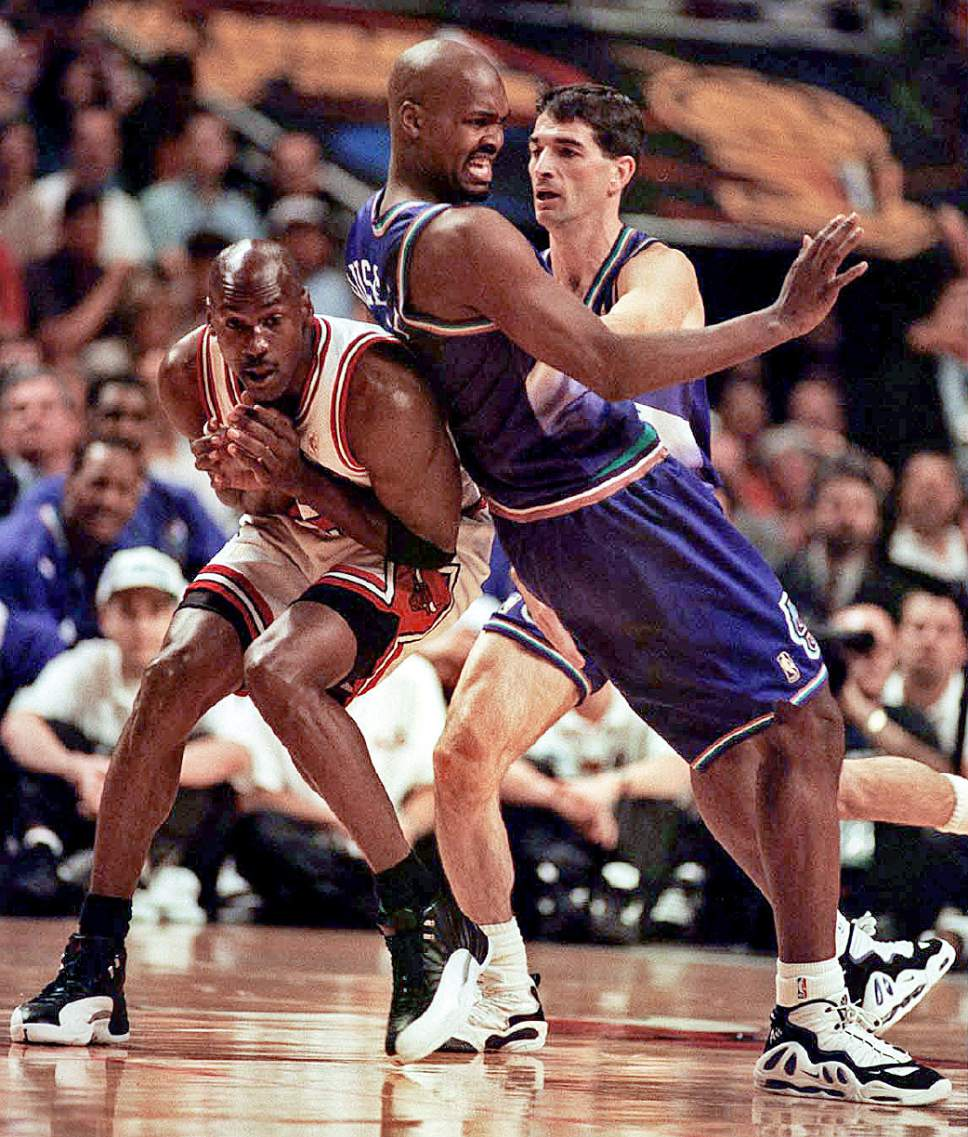 jordan, russell, stockton. trent photo. this is on the bulls offensive end, so maybe a pick.
