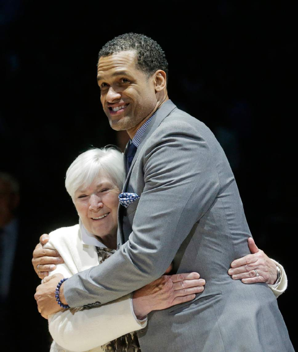Rick Bowmer  |  AP file photo   Utah Jazz owner Gail Miller and former Jazz player Stephen Howard hug during a 20-year reunion ceremony for the Jazz team that reached the 1997 NBA Finals, at halftime of the NBA basketball team's game against the New York Knicks on Wednesday, March 22, 2017, in Salt Lake City.