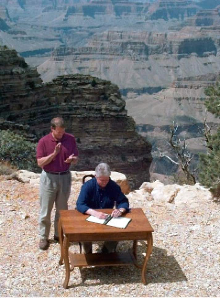 As Vice President Al Gore watches, President Clinton signs a bill declaring 1.7 million acres of southern Utah's red-rock cliff and canyons as Grand Staircase-Escalante National Monument. (AP Photo/Greg Gibson)