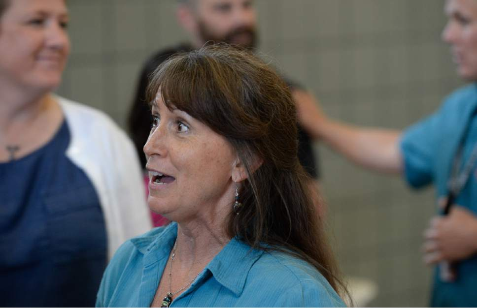 Francisco Kjolseth | The Salt Lake Tribune Sharon Ellsworth-Nielson, a Sophomore English teacher and debate coach at Park City High School, reacts to the news of a $7,000 across-the-board pay increase for teachers in the Park City School District on Wed. May 31, 2017.