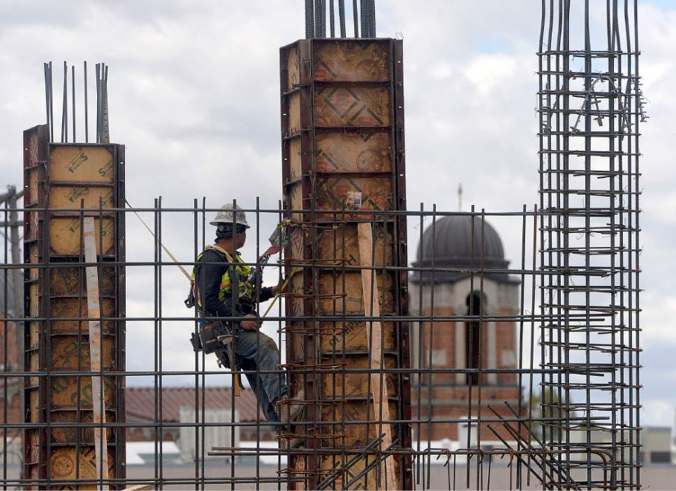 Al Hartmann  |  Tribune file photo Construction worker ties into a rebar column at large building project along 200 South between 200 West  and 300 West on Tuesday May 2.  Work was plentiful in the construction industry in March, when Utah had the industry's  third lowest  unemployment rate in the country.