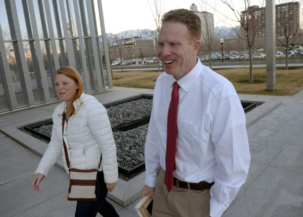 Al Hartmann  |  The Salt Lake Tribune Jeremy Johnson walks to federal court in  Salt Lake City on Tuesday, March 14, accompanied by his wife, Sharla, and lawyer Mary Coporon.  He was released from the Salt Lake County Jail on Monday and no federal authorities were on hand to take him back into custody. So he spent the night in a hotel and then turned himself back in Tuesday morning.