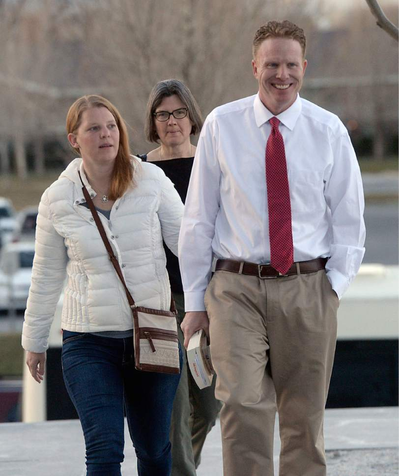 Al Hartmann  |  The Salt Lake Tribune Jeremy Johnson walks to federal court in  Salt Lake City on Tuesday, March 14, accompanied by his wife, Sharla, and lawyer Karra Porter.  He was released from the Salt Lake County Jail on Monday and no federal authorities were on hand to take him back into custody. So he spent the night in a hotel and then turned himself back in Tuesday morning.