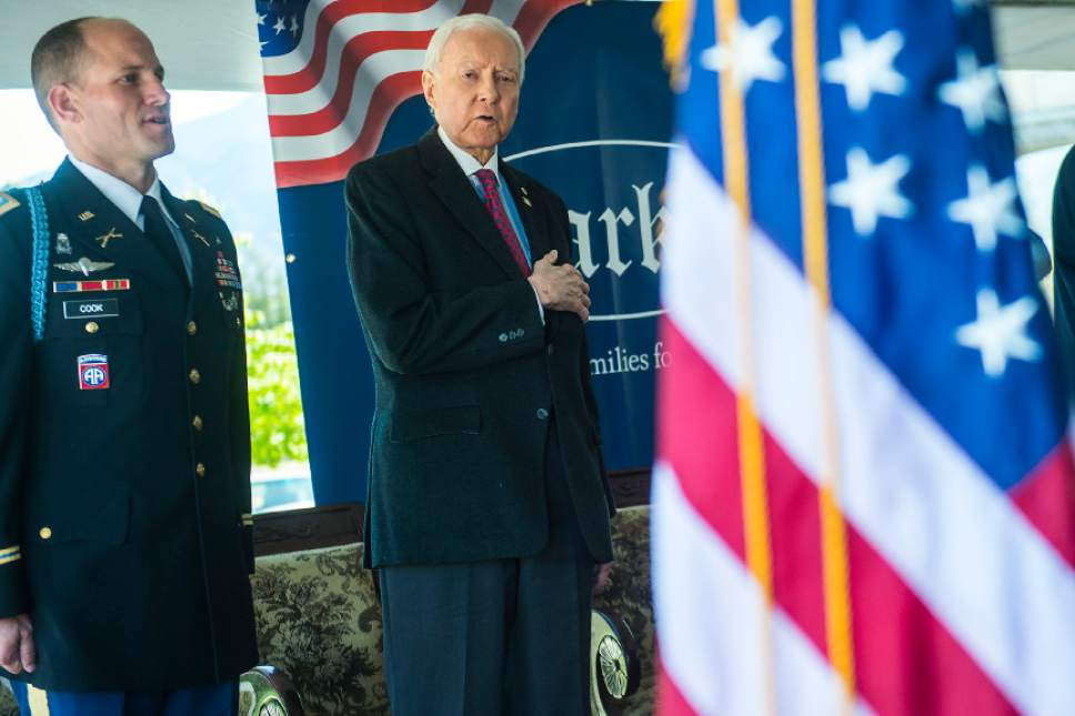 Chris Detrick  |  The Salt Lake Tribune Lieutenant Colonel Forrest 'Chip' Cook, Professor of Military Science-Army ROTC at Brigham Young University and Sen. Orrin Hatch, R-Utah, say the Pledge of Allegiance  during a Memorial Day Service at Larkin Sunset Gardens Cemetery in Sandy Monday, May 29, 2017.