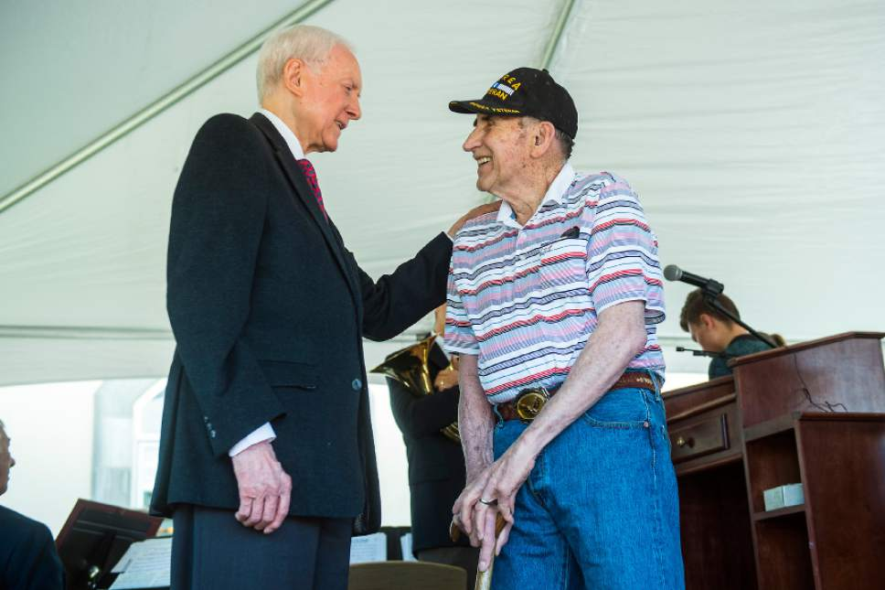 Chris Detrick  |  The Salt Lake Tribune Sen. Orrin Hatch, R-Utah, speaks with Air Force veteran Keith Loeding, who fought in the Korean War, during a Memorial Day Service at Larkin Sunset Gardens Cemetery in Sandy Monday, May 29, 2017.