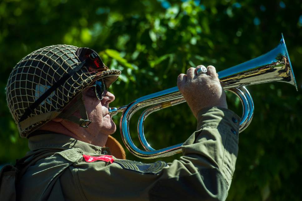 Chris Detrick  |  The Salt Lake Tribune Senior Master Sergeant John Egbert performs 'Taps' on the bugle during a Memorial Day Service at Larkin Sunset Gardens Cemetery in Sandy Monday, May 29, 2017.