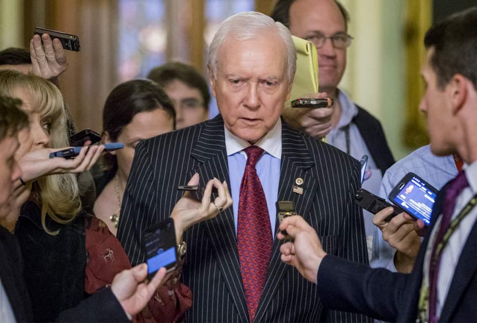 J. Scott Applewhite  | AP File Photo Sen. Orrin Hatch, R-Utah, says withdrawing from Paris Accords will benefit Americans.