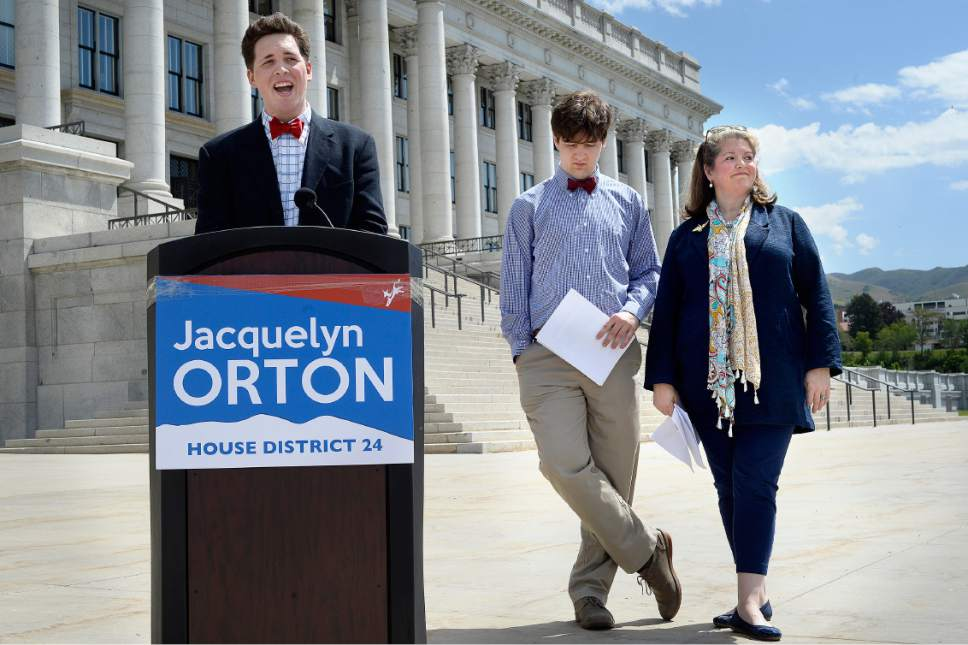 Scott Sommerdorf | The Salt Lake Tribune Wes Orton speaks about his mother as Jacquelyn Orton, widow of former U.S. Rep. Bill Orton, stands with her other son, Will, prior to announcing her candidacy for the Legislature on the south side of the Utah Capitol, Wednesday, May 31, 2017. She will be running for the District 24 seat in the Utah House of Representatives.