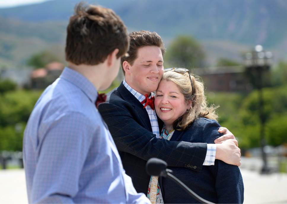 Scott Sommerdorf | The Salt Lake Tribune Jacquelyn Orton, widow of former U.S. Rep. Bill Orton, gets a hug from her son Wes prior to her announcement of her candidacy for the Legislature, Wednesday, May 31, 2017. She will be running for the District 24 seat in the Utah House of Representatives.