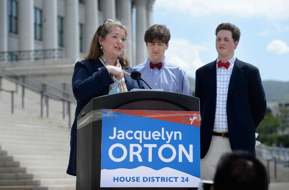 Scott Sommerdorf | The Salt Lake Tribune Jacquelyn Orton, widow of former U.S. Rep. Bill Orton, announces her candidacy for the Legislature, Wednesday, May 31, 2017. Her sons, Will, and Wes, right, are behind her. She will be running for the District 24 seat in the Utah House of Representatives.