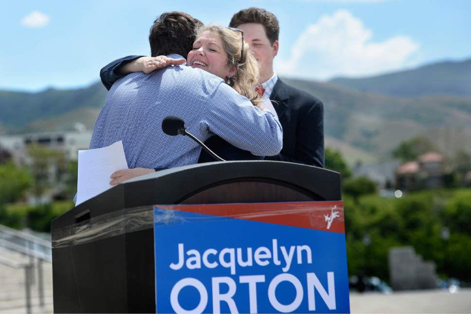 Scott Sommerdorf | The Salt Lake Tribune Jacquelyn Orton, widow of former U.S. Rep. Bill Orton, hugs her son Will, left, after his speech introducing her. Her other son, Wes, is at right. She announced her candidacy for the Legislature, Wednesday, May 31, 2017. She will be running for the District 24 seat in the Utah House of Representatives.