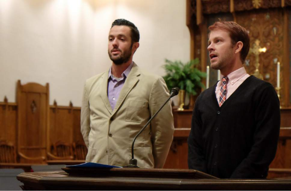 "Francisco Kjolseth | The Salt Lake Tribune Michael Adam Ferguson, left, and his husband J Seth Anderson, repeat the joyful Aramaic exclamation of praise, ""hosanna, hosanna, hosanna, for justice and peace for all"" concluding a Christmas interfaith service is held at St. Paul's Episcopal Church in Salt Lake to affirm the dignity and worth of all people. The service, titled ""Seeing Christ In Every Child,"" was prompted by ongoing spiritual isolation and pain expressed by LGBTQ people of faith."