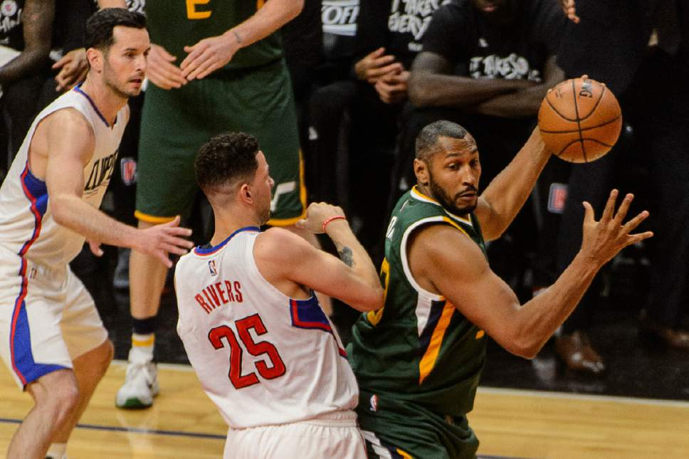 Trent Nelson  |  The Salt Lake Tribune Utah Jazz center Boris Diaw (33) defended by LA Clippers guard Austin Rivers (25) as the Utah Jazz face the Los Angeles Clippers in Game 7 at STAPLES Center in Los Angeles, California, Sunday April 30, 2017.