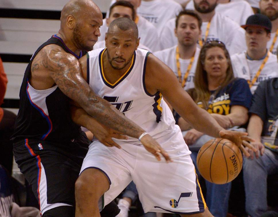Leah Hogsten  |  The Salt Lake Tribune  LA Clippers center Marreese Speights (5) pressures Utah Jazz center Boris Diaw (33). The Utah Jazz lead the Los Angeles Clippers after the third quarter during Game 3 of their first-round Western Conference playoff series at Vivint Smart Home Arena, Friday, April 21, 2017.