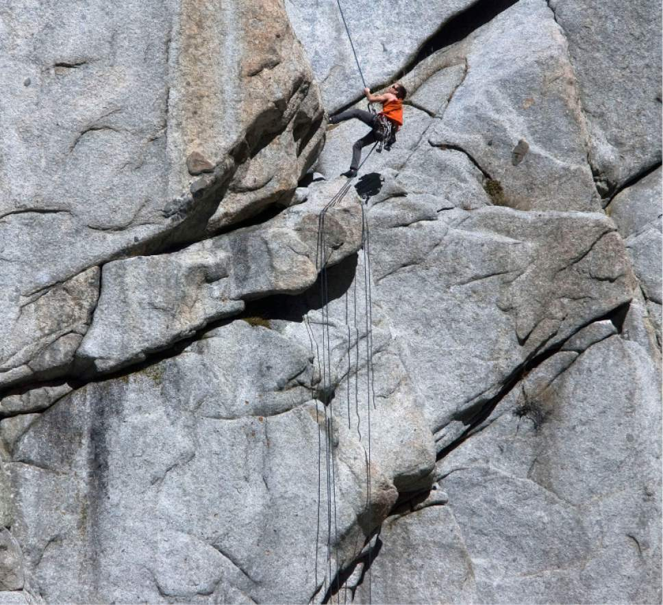 Steve Griffin  |  The Salt Lake Tribune  Rock climbers enjoy the warm temperatures as they climb the granite walls at the mouth of Little Cottonwood Canyon, Utah  Monday, March 5, 2012.