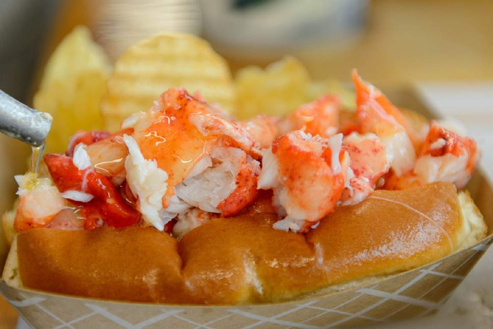 Trent Nelson  |  The Salt Lake Tribune A lobster roll gets a layer of hot butter at Freshie's Lobster Co. in Park City.