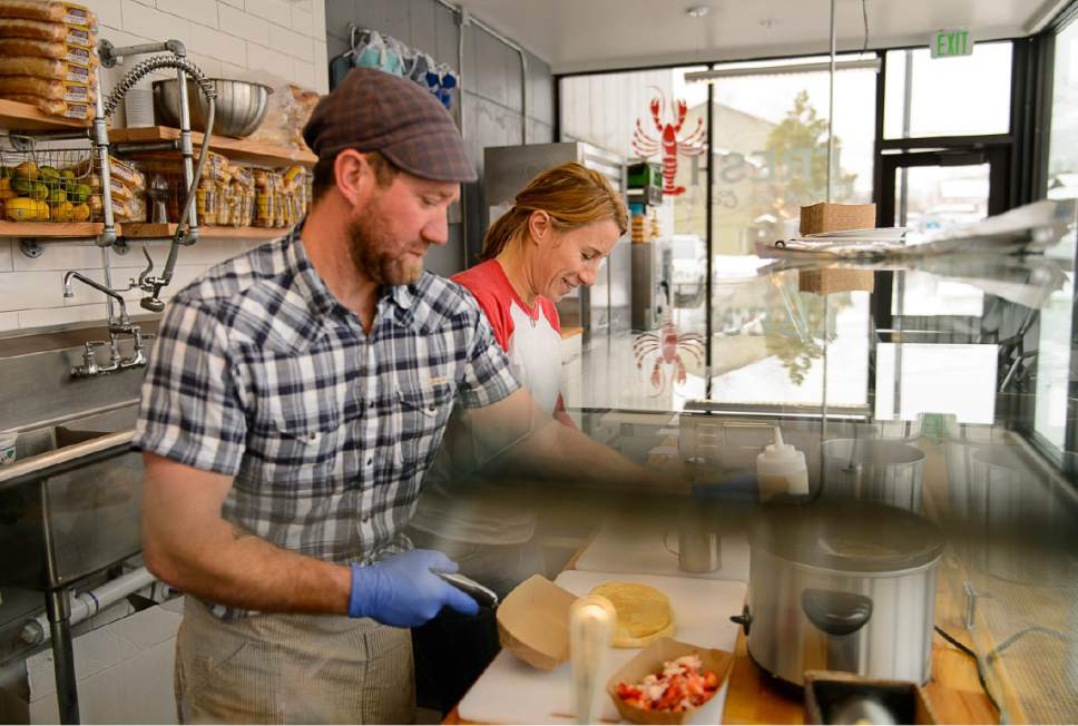 Trent Nelson  |  The Salt Lake Tribune Dale Hentzell and Lorin Smaha at work at Freshie's Lobster Co. in Park City, Tuesday, Jan. 10, 2017. This summer Freshie's Lobster Co. became one of Park City's most popular food trucks. Recently the owners, Ben and Lorin Smaha, opened their first sit-down store. The menu includes lobster rolls, clam chowder, salads and food with a taste of New England where the Smahas were both born and raised.