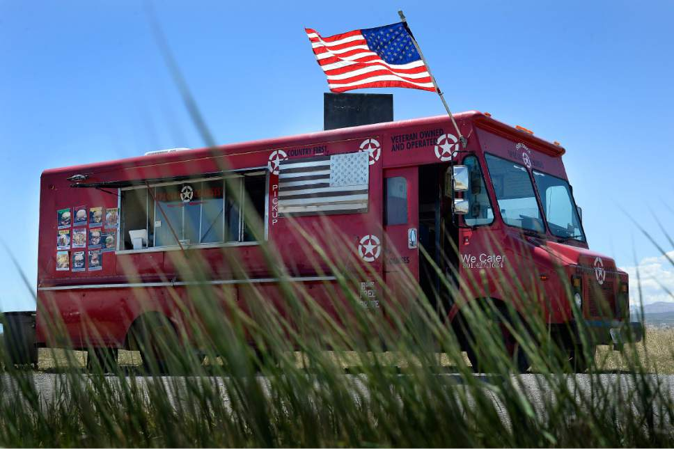 Scott Sommerdorf | The Salt Lake Tribune The Special Courses food truck, Saturday, May 27, 2017. Special Courses is a two-year-old food truck owned by Iraq war veteran James Veylupek, who serves food with a military theme, like the Whiskey-Tango-Foxtrot burger.
