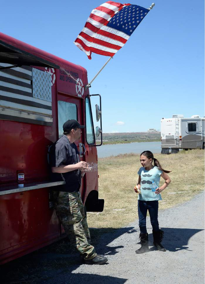Scott Sommerdorf | The Salt Lake Tribune James Veylupek, owner of the Special Courses food truck takes a break to eat lunch with his daughter Katie, Saturday, May 27, 2017.