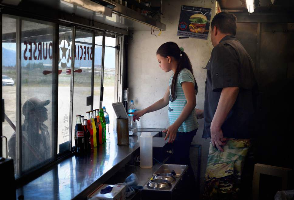 "Scott Sommerdorf | The Salt Lake Tribune James Veylupek works alongside his daughter Katie, 10, in the Special Courses food truck, Saturday, May 27, 2017.   Special Courses, is a two-year-old food truck owned by Iraq war veteran James Veylupek, who serves food with a military theme, like the Whiskey-Tango-Foxtrot burger.  J the owner, also recently won the ""Taste of the Space"" contest sponsored by the Utah Restaurant Association. He gets 6 months free rent and $50,000 to open a stand-alone spot in the South Towne Mall."