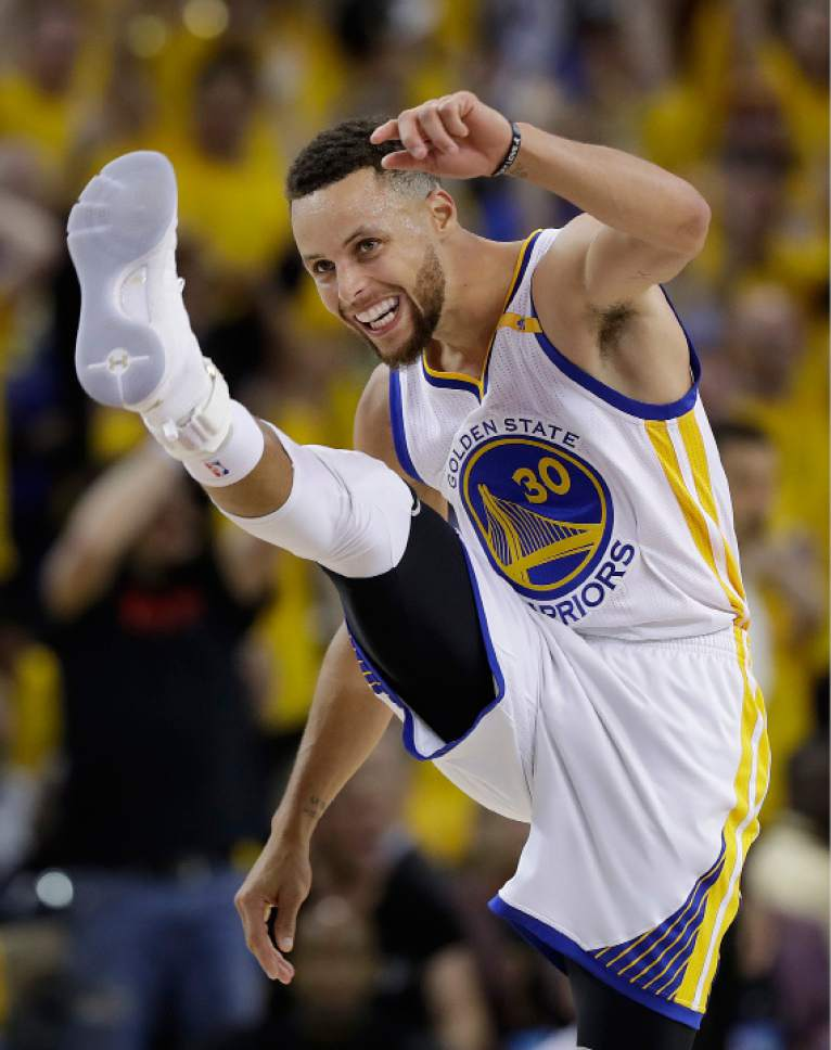 fe8fa4fd7ea3 Golden State Warriors guard Stephen Curry (30) reacts after scoring against  the Cleveland Cavaliers