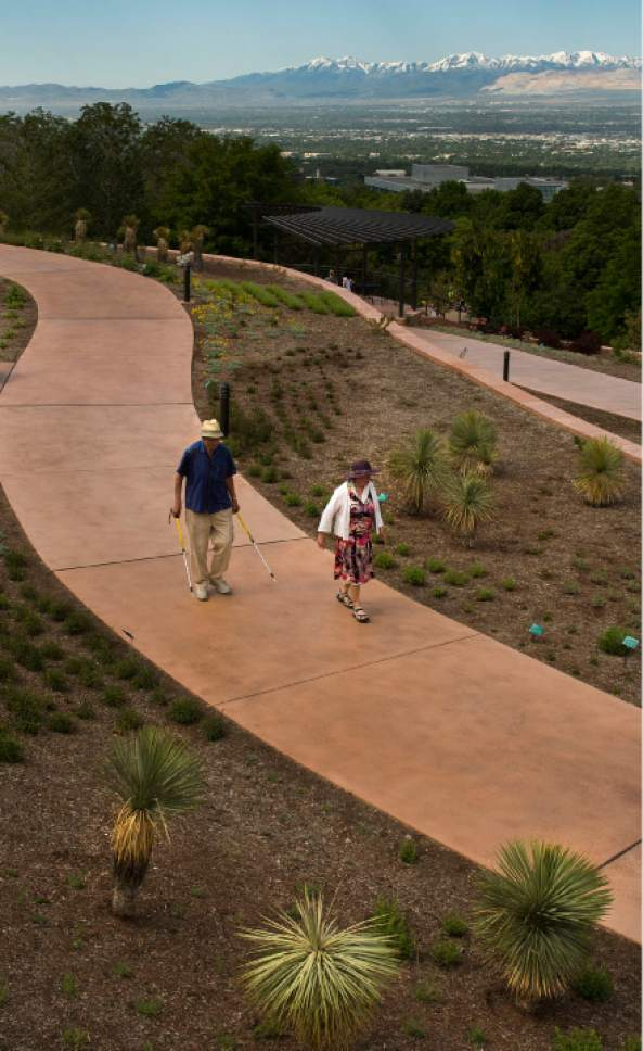 "Leah Hogsten  |  The Salt Lake Tribune Siegfried, left, and Ellen Karsten have been members of Red Butte Garden for 30 years, and say they walk the garden paths 4-5 times a week for their ""Vitamin N,"" which stands for ""nature."""